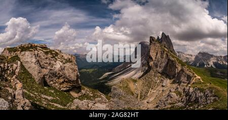 Panoramic view of the steep, rough cliffs and summits of the montain formation Seceda, Secèda, part of the Puez-Geisler Nature Park - Stock Photo