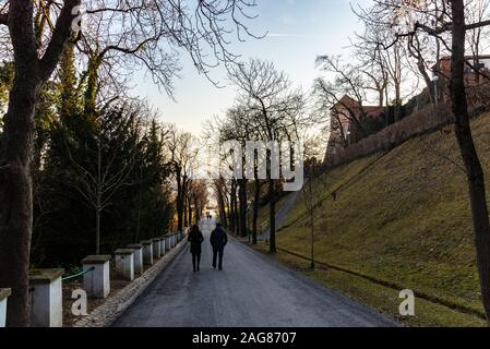 Schlossberg Castle mountain in Graz, people walking down the hill on path - Stock Photo