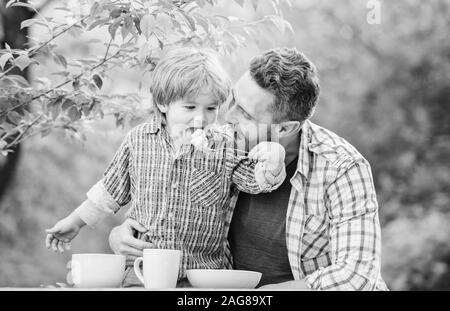 Preparation of food. healthy food and dieting. Happy family together. happy fathers day. Little boy with dad. son and father eating milk porridge. childhood happiness. Food habits. love concept.