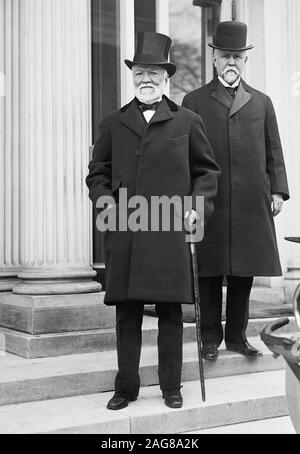 Vintage photo of Scottish-American industrialist and philanthropist Andrew Carnegie (1835 – 1919) and, behind and to the right of him, American banker and politician Theodore P Gilman (1841 – 1930). Photo circa 1914 by Harris & Ewing. - Stock Photo