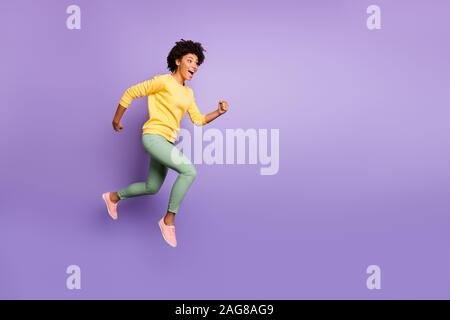 Full size profile side photo of crazy funky afro american girl jump hurry after spring discounts move fast feel carefree expression wear casual style - Stock Photo