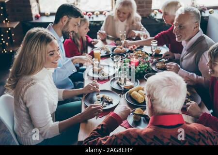 Photo of full family gathering sitting around dinner table communicating x-mas party tradition all together son daughter grandma grandpa in noel - Stock Photo