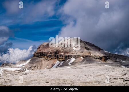 The summit of Piz Boè, the highest mountain of the Sella Group, from the plateau Sass Pordoi, dark thunderstorm clouds moving in - Stock Photo