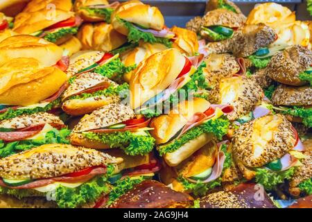 Lots of sandwiches in a display window of a diner cooking for sale - Stock Photo