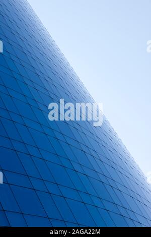 Blue glass windows business building facade and sky background. - Stock Photo