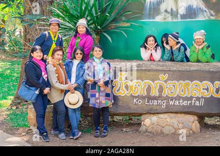 LAMPHUN THAILAND - DECEMBER 9 :  Group of tourists take pictures with national park sign on December 9,2019 at Mae Ping National Park in Lamphun, Thai - Stock Photo