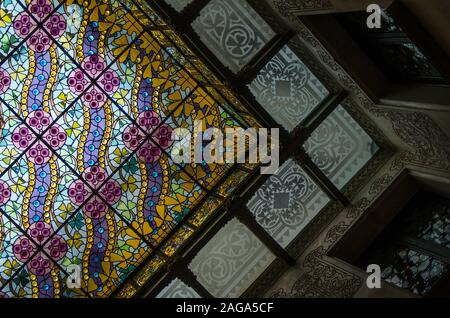 A low angle shot of a ceiling created with colorful glass looking like a work of art - Stock Photo