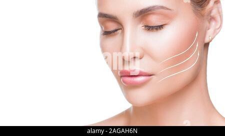 Portrait of attractive woman with arrows on her face over white background. Face lifting concept. Plastic surgery treatment, medicine. - Stock Photo