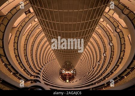 Interior of Jin Mao Tower looking down to the lobby of the Grand Hyatt Hotel, Shanghai, China - Stock Photo