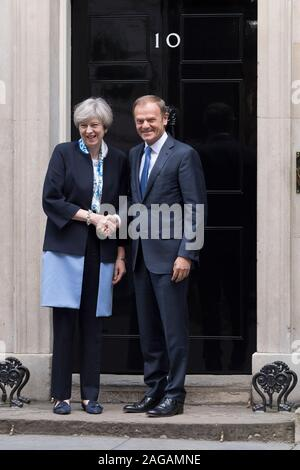 Theresa May, the British Prime Minister, greeting Donald Tusk, President of the European Council, as he arrives at 10 Downing Street, London, UK. - Stock Photo