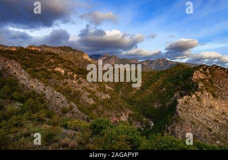 The Sierra de Enmedio, mountain massif rising a behind Frigiliana in the province of Malaga, Andalusia, Spain. - Stock Photo