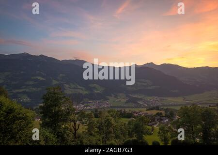 Colorful sunset over the valley Zillertal in Tirol, Austria - Stock Photo