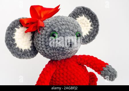 Portrait of a teddy mouse with a red bow on its head - Stock Photo