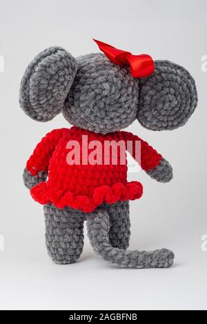Plush mouse with a red bow on its head, Rear view - Stock Photo