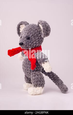 Funny knitted teddy mouse, Side view, white background - Stock Photo