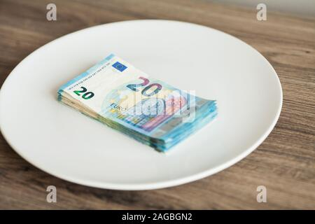 Money lying on the plate. Euros photo. Greedy corruption concept. Bribe idea. - Stock Photo