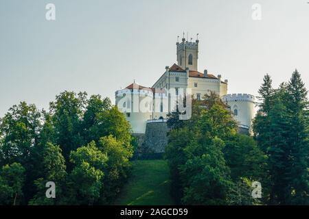 A low angle shot of the famousTrakoscan Castle in Croatia under the dark gray sky - Stock Photo