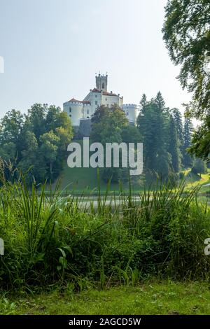 A vertical low angle shot of the famousTrakoscan Castle in Croatia under the dark gray sky - Stock Photo