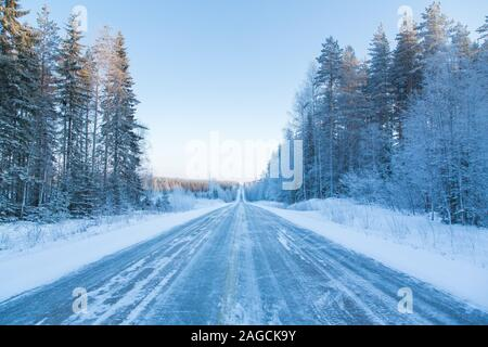 Wintery road in Finland - Stock Photo