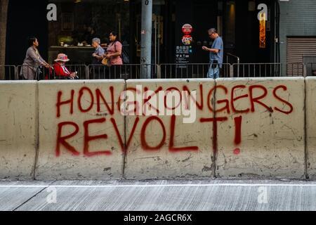 HongKong - November, 2019:   Graffiti reading 'Hongkongers revolt !' during the 2019 Hong Kong protests, a series of demonstrations in Hongkong - Stock Photo