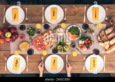 Family at the table. Festive table set for six people - Stock Photo