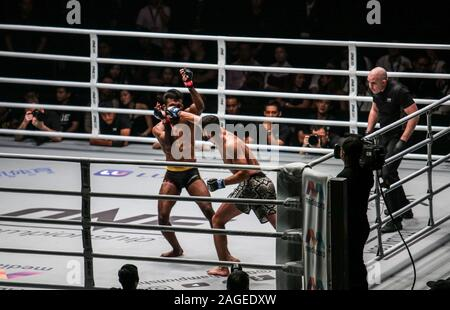 SINGAPORE, SINGAPORE - Nov 22, 2019: Pakistani fighter Furqan Cheema lands a punch on Indian opponent Rahul Raju during his eventual submission loss a - Stock Photo