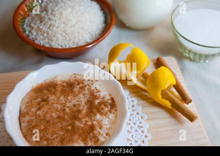 Rice pudding and ingredients. Close view. - Stock Photo