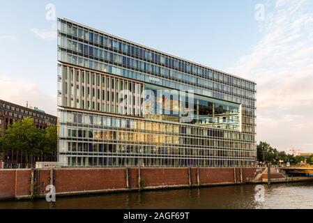 Hamburg, Germany - August 3, 2019: Deichtor Office Building in the port of Hamburg, designed by Hadi Teheran architect - Stock Photo