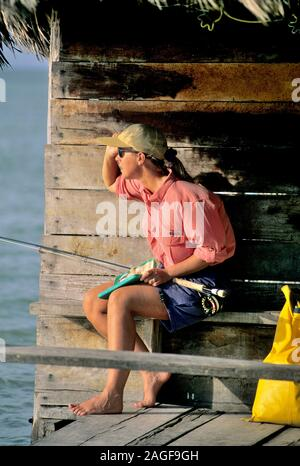 Female angler looks for fish in Mexico - Stock Photo