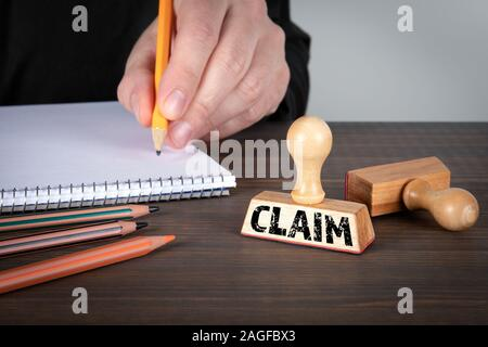 Claim. Service, quality and communication concept. Rubber Stamp on desk in the Office - Stock Photo