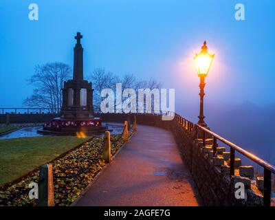 The War Memorial in the Castle Grounds on a misty evening at Knaresborough North Yorkshire England