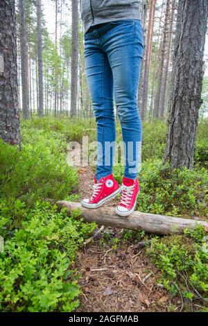 Converse All Star trainers in bright colour worn by a young female - Stock Photo