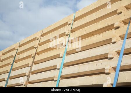 Wooden building elements loaded on a truck in traffic - Stock Photo