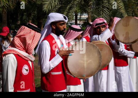 Bahraini musicians playing traditional music on tars (drums) on the opening day of the farmers market, 2019, Budaiya, Kingdom of Bahrain - Stock Photo