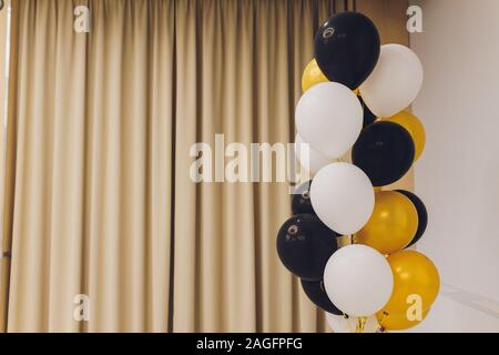 Balloons balloon white with black heart and yellow golden with greenery helium photo shoot wall - Stock Photo