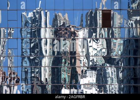 City reflection on a blue curtain wall, Hong Kong - Stock Photo
