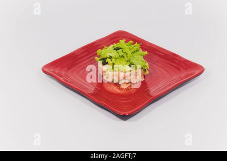 Salad with salmon, caviar and arugula on a white background - Stock Photo