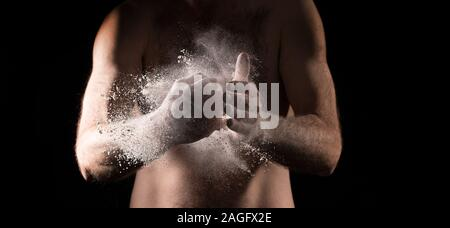 Box and fight, Boxer rubbing powder in hand for grip, Hand of boxer over black background , punching hand, fist , fast punch - Stock Photo