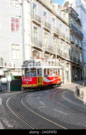 Lisbon, Portugal / 6 November 2015: view of the historic Number 12 tram traveling through downtown Lisbon in Portugal - Stock Photo