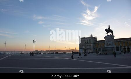 Lisbon, Portugal / 6 November 2015: the famous Praca de Comercio Square in the heart of Lisbon at sunset with many pedestrians - Stock Photo