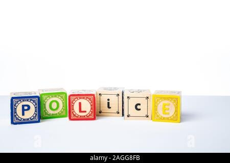 Childrens Wooden Alphabet Blocks Spelling the Word Police - Stock Photo