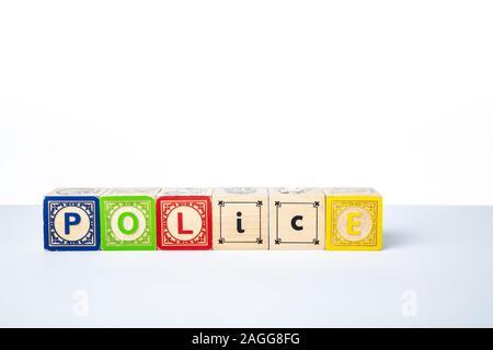 Childrens Wooden Alphabet Blocks Spelling the Word Police - Stock Photo