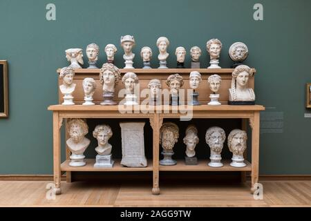 Classical statue, view of a collection of classical Roman and Greek busts sited on a display table in the Ny Carlsberg Glyptotek museum, Copenhagen. - Stock Photo