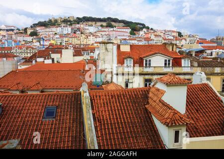 Lisbon, Portugal : Baixa downtown roofs overview towards Sao Jorge Castle as seen from the Santa Justa elevator. - Stock Photo