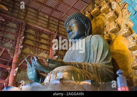 NARA, JAPAN - MAY 17, 2017: The Todaiji Buddha. It is considered  the world's largest bronze statue of the Buddha Vairocana. - Stock Photo