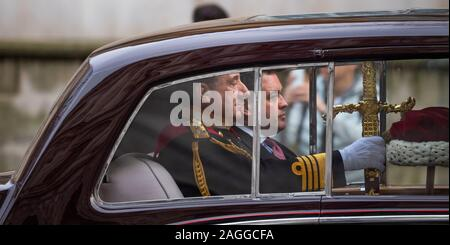 Whitehall, London, UK. 19th December 2019. The State Opening of Parliament. The Great Sword of State and Cap of Maintenance travel by motorcade to Parliament before the Sovereign arrives. Credit: Malcolm Park/Alamy Live News. - Stock Photo