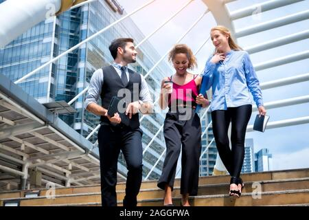 Business People Walking Handshake Professional Urban City Concept., Business people working in office on desktop computer, Group of happy business peo
