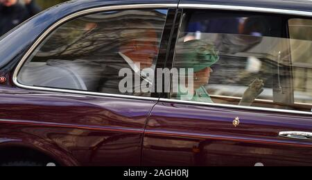 Whitehall, London, UK. 19th December 2019. The Queen accompanied by Prince Charles attends Parliament to deliver The Queen's Speech, travelling in a motorcade and not wearing ceremonial dress. Credit: Malcolm Park/Alamy. - Stock Photo