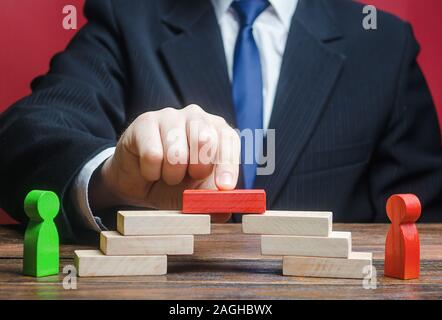 The man provides the conditions for negotiations and conflict resolution between opponents. Arbitrator mediator. Search for compromise. Confrontation - Stock Photo