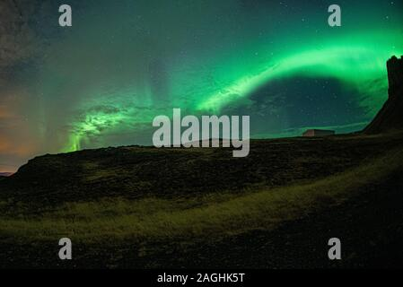 Aurora Borealis (Northern lights) dancing over Iceland. - Stock Photo